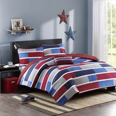 For a simple update to your space, this Mizone Nicholas coverlet set is a perfect solution. Small colorblocks of navy, medium blue, grey and red are printed on polyester microfiber for easy care and ideal home decor.