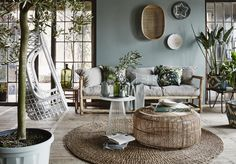 Home design ideas / Home inspirations |  If you want your living room to be your weekend retreat during this season, you need to get lots of plants and place them in this room. The final touch is a suspended chair.