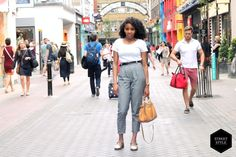 This is a great example of street style; we caught Natalie dashing from work and we immediately fell in love with this look as it is smart, chic and will work for all women. Those grey trousers from American Apparel teamed with a white t-shirt is a great match. #blackballad #streetstyle #fashion