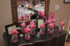 Gather photos of your guests who can't be with you on your wedding day, and display them inside mason jars for a unique twist on a photo table.