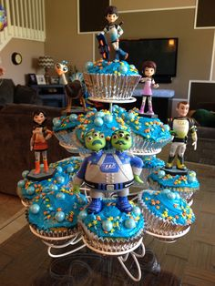 "Miles from Tomorrowland Birthday Party Ideas and Themed Party Supplies | These Miles from Tomorrowland cupcakes are easy to decorate with small 4"" figurines of the characters from the show."