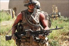 A British Army 2 Para machine gunner with L7A2 medium machine gun in Afghanistan.