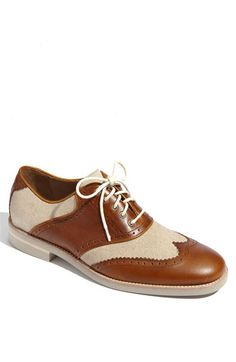 b3c778f9b8d A dapper wingtip gets a warm-weather update with breezy linen color blocks.  Leather
