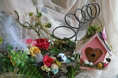 Floral with Spring Bird House and Rusty Bed Coil (birdhouse centerpiece idea)