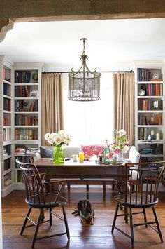 love the bookshelves with bench between <3