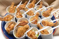 Great big crowd catering idea.  Cole slaw on the bottom of the cup, and tiny drumsticks on top