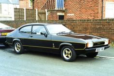 """Ford Capri mk II JPS. My Capri looked just like this one but was an """"S"""" rather than a """"JPS"""" (silver and black upholstery rather than gold and black). It was a fantastic car - wish I still had it (still have the front grill)."""