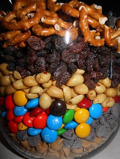 Monster Trail Mix  Monster Trail Mix   It's Tastefully Tuesday...        My husband and I love Archer Farm's (aka Target) Monster Trail Mix.   The Ingredients  Salted Peanuts  Raisins  M's Candy  Peanut Butter Chips  Chocolate Chips  Pretzels  Chex cereal, cashews, walnuts, etc.