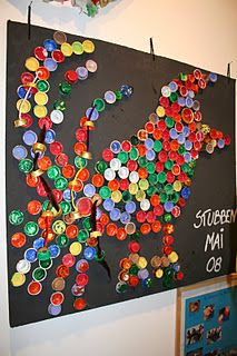 bottle caps! this would make a great collaborative project- lots of negotiation and decision making - ask parents to start saving bottle caps of all sizes and colors