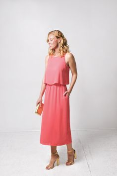 The perfect nursing dress to wear to a wedding! Easy lift up access to nurse on the go and a beautiful coral color that just pops!