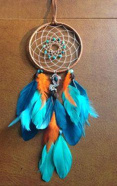 The Modern Dreamer-https://www.etsy.com/listing/213401776/dream-catcher-peacock-blue-and-orange