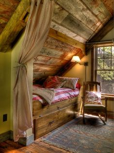 great use of space for a bedroom with a sloped ceiling. Rustic Bedroom in a cabin.