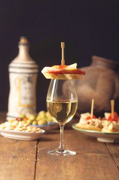 """Tapas - a cover to keep the flies out of ones glass. The word """"tapas"""" is derived from the Spanish verb """"tapar"""", which means """"to cover"""". Soooo they HAVE to be served with wine! Spanish Tapas, Spanish Food, Speak Spanish, Tapas Party, In Vino Veritas, Wine Cheese, Wine Tasting, Wine Recipes, Just In Case"""