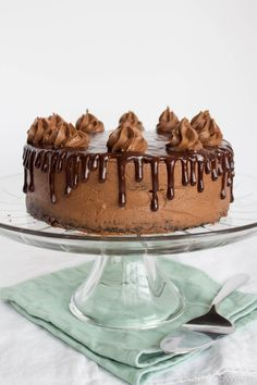 A two-layer decadent mocha chocolate cake with a rich, creamy coffee frosting and a homemade chocolate ganache dripped around the sides.
