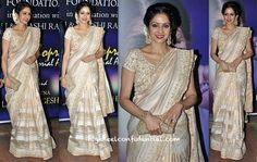 Sridevi went the the more traditional route while at a recent Award presentation. Pairing her sari with some flowers, bindi, a glitter-ey clutch and beautiful jewelry, she hit quite the home run.