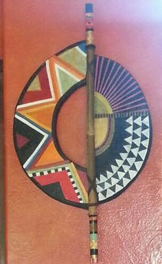 Contemporary African Shield #4. Shield is of mixed media construction with a cutout and accented with a painted and beaded bamboo pole.