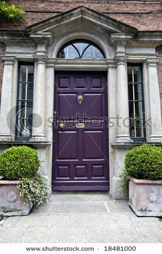 Eggplant front door.  Kinda cool. Love it. Wouldn't work with our house, however thinking I might need a purple door somewhere inside the house!!
