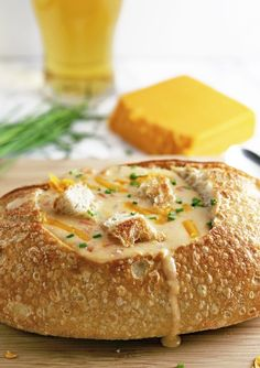 This slow cooker beer cheese soup is super easy to make! It combines sharp cheddar cheese, cream cheese and beer and is delicious for lunch or dinner. Serve it with crusty bread or like me, in a sour dough bread bowl!   honeyandbirch.com