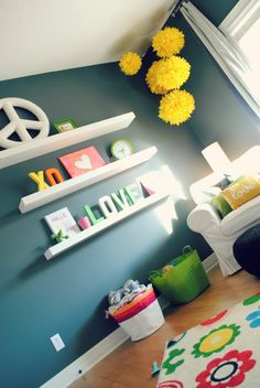 Fun, colorful decor in this navy nursery - #nurserydecor
