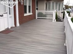 Nice gray deck with white railings.