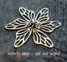 Gold Plate over Bronze Butterfly Wing Charms. Flutter over to http://www.ninadesigns.com/bali_bead_shop/gold_plated_bronze_butterfly_wing_charm/vga943/finishes to purchase.