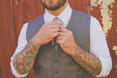 Groom with tattoos. Michigan Wedding Photos: Stevie + Daniel. See the photos at http://theweddingatlas.com/michigan-wedding-photos-stevie-daniel/