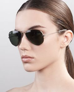 A true blue American Style icon: Ray-Ban Aviators.  I have multiple pairs and never globe-trot without them.  Original Aviator Polarized Sunglasses, Green by Ray-Ban at Neiman Marcus.