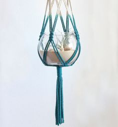 Macrame hanging terrarium...I want to learn how to do macrame! It brings back memories of my early teens. I had a purple macrame plant hanger in my bedroom.