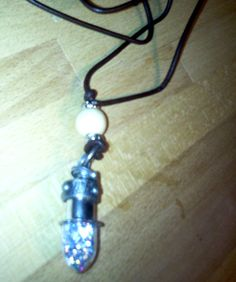 Unique Bullet Shaped Pendant Filled with Glitter by RuggedCross777, $5.99