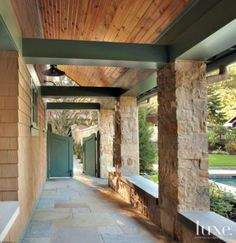 Wooden covered outdoor walkway with green paneling