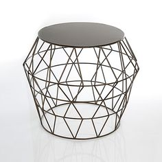 Embrace geometry with this fun openwork side table. The metal wire sides weave in and out with a rich, playful mix of trendy triangles.