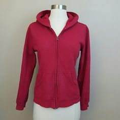 Red full zip hoodie Red long sleeved hoodie with a full zipper.  Size petite medium.  Fits snug.  80% cotton, 20% polyester.  Some of the color has chipped off the zipper pull. Tops Sweatshirts & Hoodies