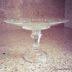 Crafty Creations: DIY Cake Stand  here's what you will need:  a plate  base of your choice (candle holder, martini glass, ramekin etc.)  industrial strength glue    The steps are simple and the end product is too sweet to pass up. I love the idea of spray painting the finished piece to make it one solid color