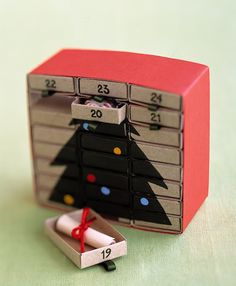 diy 25 days of Christmas advent calendar is made up of several match boxes and is perfect to put little surprises inside.