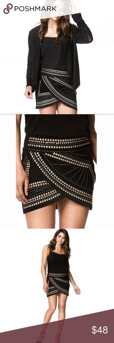 """Rocker Style Wrap Studded Mini Skirt ❤️ BUNDLES ❌ NO TRADES ❌ NO Low balling!  • This skirt stretches • STUDS ARE VERY STURDY. LONG LASTING GUARANTEED! * MEASUREMENTS • S - Waist: 24.5"""" - 26"""" Apprx - Length Front at peak of opening: 13.5"""" Apprx - Length Back: 15.25"""" Apprx • M - Waist: 27"""" - 28.5"""" Apprx - Length Front at peak of opening: 14"""" Apprx - Length Back: 15.75"""" Apprx • L - Waist: 28"""" - 29.75"""" Apprx - Length Front at peak of opening: 14.55"""" Apprx - Length Back: 16.25"""" Apprx * MATERIAL…"""