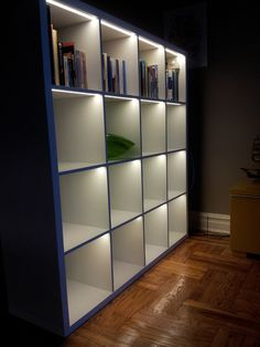 Add lights to the IKEA KALLAX to display your books and other memorabilia.