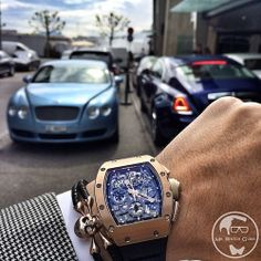 Richard Mille RM011 in rose gold with @Sting HD skull bracelet and a Bentley Rolls Royce background next to Kempinski