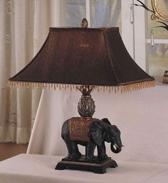 Antique Elephant Style Table Lamp Set is the perfect home or office decor accentAntique look elephant table lamp setComes with two accent lamps
