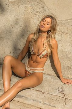 Capittanas new releases just keep getting better and better. This stunning designer crochet bikini is known as their Roatan Bikini Set. Featuring a triangle top made in a neutral color and combined with crochet and a ruffled lining to perfection. #onepiece