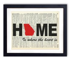 Georgia Home Is Where The Heart Is Upcycled Vintage Dictionary Art Print 8x10. Each design is printed on an authentic antique dictionary page from the early to mid-1900's. The pages that are used for each print are random pages from a vintage dictionary. Each page has a great antique look and feel. You will receive the exact image shown however the dictionary pages that are used will vary. This makes each print a one of a kind, as no two pages will be exactly the same. Each print measures...