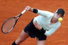 Bethanie Mattek-Sands of the U.S. serves to Maria Kirilenko of Russia during their womens singles match at the French Open tennis tournament at the Roland Garros stadium in Paris June 3, 2013. REUTERS/Stephane Mahe