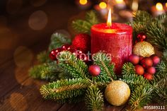 Burning candle in festive christmas arrangement