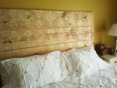 plank headboard - using hardware store lumber, brackets, and spray paint... leaned up against the wall