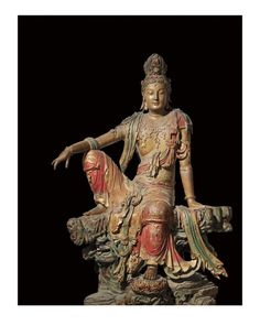 Bodhisattva Guanyin  1th/12th century A.D.; Polychromed Wood; Chinese;Shanxi Province; Liao Dynasty (A.D. 907-1125)    The Bodhisattva Guanyin, the Chinese Buddhist deity of compassion and mercy, here is seated in the posture of royal ease on a simulated outcropping of craggy, perforated rock. The position of the Guanyin conveys the impression that the Bodhisattva might at any moment awake from a state of deep contemplation and step down from the carved lotus rest. The Bodhisattva's…