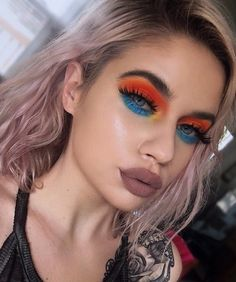The stunning @laurenrohrer smolders in 'Slayer' lashes, a neon orange lid, azul colored lower lash line paired with a totally 90's lip. Hot damn, babe. #blackmagiclashes