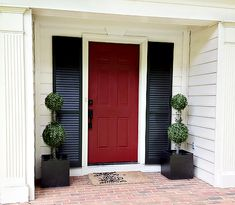 Shutters on each side of front door  |  7th House on the Left