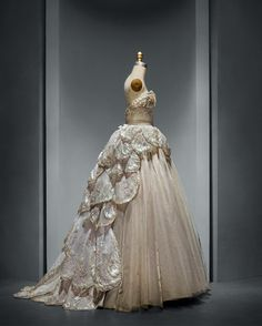 "House of Dior (French, founded 1947), Christian Dior (French, 1905–1957). ""Venus"" Dress, autumn/winter 1949–50, Haute Couture. Machine–sewn, hand–finished gray silk taffeta and tulle; hand–applique of gray silk tulle and horsehair petals, hand–embroidered with opalescent, gold, and silver gelatin sequins, feather paillettes, synthetic pearls, and clear crystals. Photo © Nicholas Alan Cope. #ManusxMachina #CostumeInstitute"