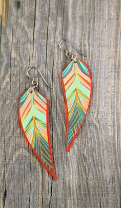 hand painted birch wood feather and niobium earrings by bootsravendesigns, $34.00