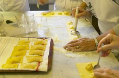 Taking a culinary class in Italy. | 10 Trips To Take That Will Actually Teach You Something Italy offers an array of different cooking classes where you can learn traditional Italian recipes and experience world-class wine tours. Experiencing Italy through its food and wines allows you to truly live la dolce vita.