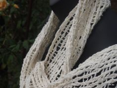 White leno lace handwoven scarf, woven on a rigid heddle loom. Metafour Studio.